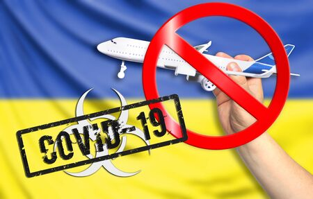 A new coronavirus disease called COVID - 19 with the flag of Ukraine. Contains the concept of a ban on air travel between countries.