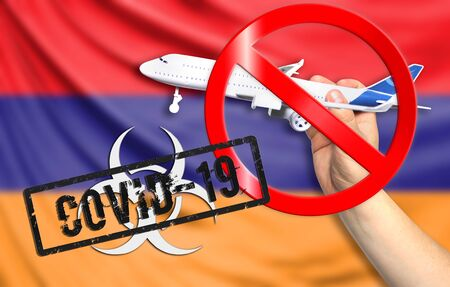 A new coronavirus disease called COVID - 19 with the flag of Armenia. Contains the concept of a ban on air travel between countries. Фото со стока