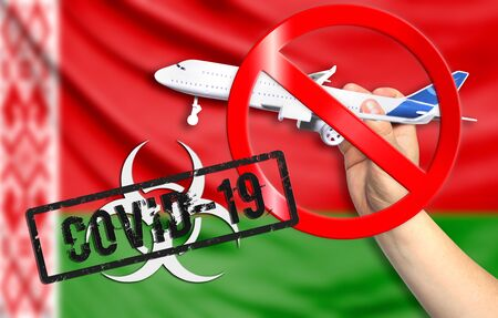 A new coronavirus disease called COVID - 19 with the flag of Belarus. Contains the concept of a ban on air travel between countries.