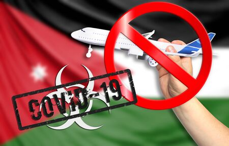 A new coronavirus disease called COVID - 19 with the flag of Jordan. Contains the concept of a ban on air travel between countries. Фото со стока