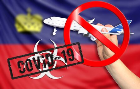 A new coronavirus disease called COVID - 19 with the flag of Liechtenstein. Contains the concept of a ban on air travel between countries.