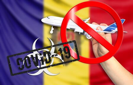A new coronavirus disease called COVID - 19 with the flag of Moldova. Contains the concept of a ban on air travel between countries. Фото со стока