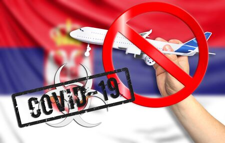 A new coronavirus disease called COVID - 19 with the flag of Serbia. Contains the concept of a ban on air travel between countries. Фото со стока