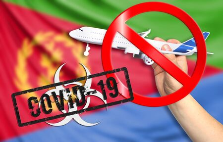 A new coronavirus disease called COVID - 19 with the flag of Eritrea. Contains the concept of a ban on air travel between countries.
