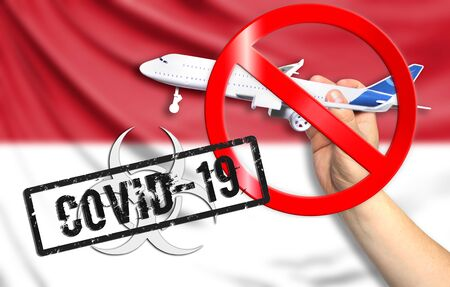 A new coronavirus disease called COVID - 19 with the flag of Indonesia. Contains the concept of a ban on air travel between countries.