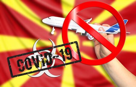 A new coronavirus disease called COVID - 19 with the flag of Macedonia. Contains the concept of a ban on air travel between countries.