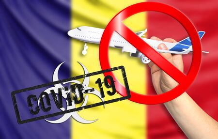 A new coronavirus disease called COVID - 19 with the flag of Romania. Contains the concept of a ban on air travel between countries. Фото со стока