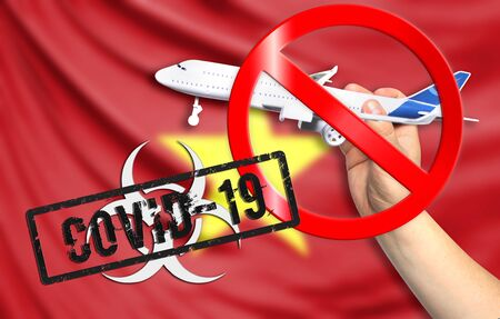 A new coronavirus disease called COVID - 19 with the flag of Vietnam. Contains the concept of a ban on air travel between countries. Фото со стока