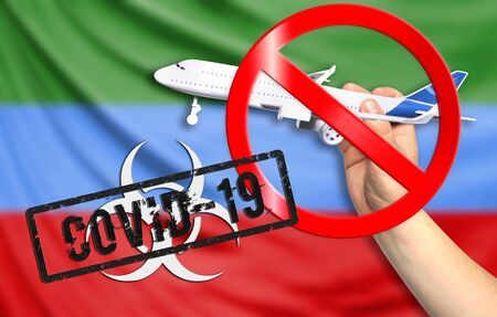 A new coronavirus disease called COVID - 19 with the flag of Dagestan. Contains the concept of a ban on air travel between countries. Фото со стока