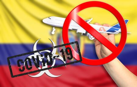 A new coronavirus disease called COVID - 19 with the flag of Ecuador. Contains the concept of a ban on air travel between countries. Фото со стока