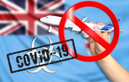 A new coronavirus disease called COVID - 19 with the flag of Fiji. Contains the concept of a ban on air travel between countries. Фото со стока