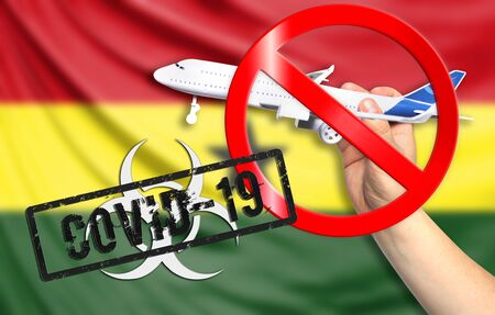 A new coronavirus disease called COVID - 19 with the flag of Ghana. Contains the concept of a ban on air travel between countries. Фото со стока