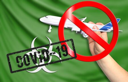 A new coronavirus disease called COVID - 19 with the flag of Libya. Contains the concept of a ban on air travel between countries. Фото со стока