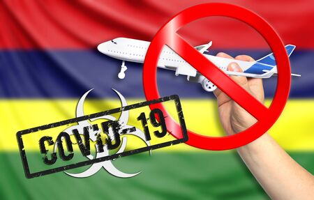 A new coronavirus disease called COVID - 19 with the flag of Mauritius. Contains the concept of a ban on air travel between countries.