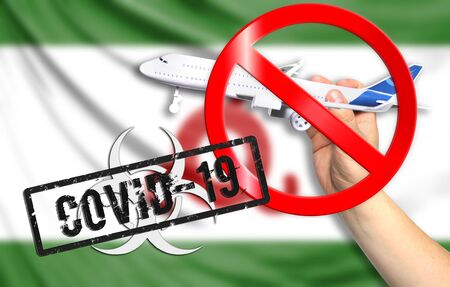 A new coronavirus disease called COVID - 19 with the flag of Ingushetia. Contains the concept of a ban on air travel between countries.