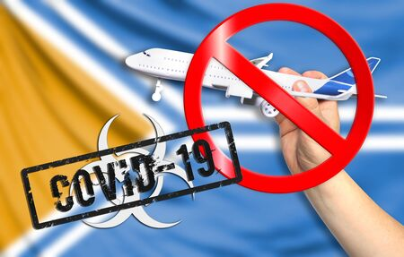 A new coronavirus disease called COVID - 19 with the flag of Tuva. Contains the concept of a ban on air travel between countries. Stock Photo