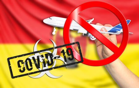 A new coronavirus disease called COVID - 19 with the flag of Burgenland. Contains the concept of a ban on air travel between countries. Stock Photo