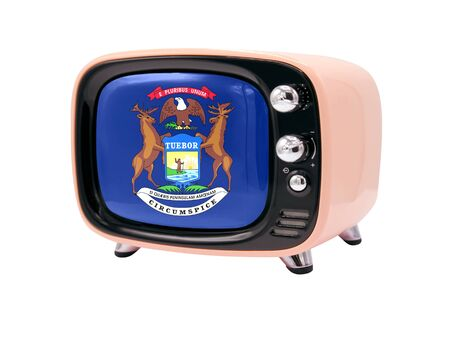 The retro old TV is isolated against a white background with the flag State of Michigan 免版税图像