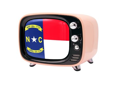 The retro old TV is isolated against a white background with the flag State of North Carolina 免版税图像
