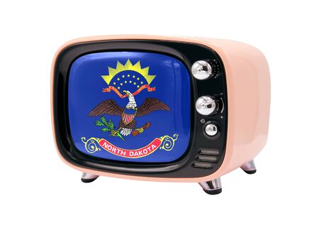 The retro old TV is isolated against a white background with the flag State of North Dakota 免版税图像