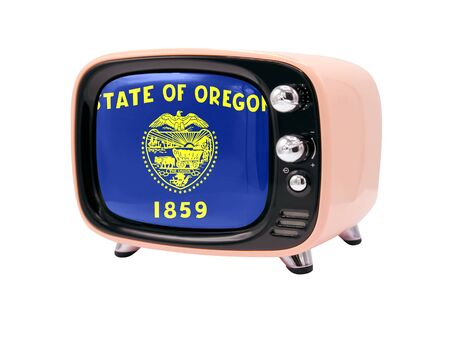 The retro old TV is isolated against a white background with the flag State of Oregon 免版税图像