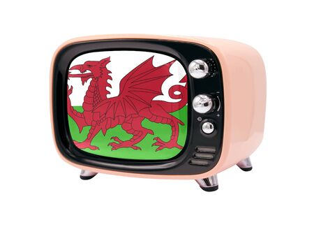 The retro old TV is isolated against a white background with the flag of Wales