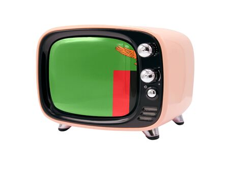 The retro old TV is isolated against a white background with the flag of Zambia 版權商用圖片