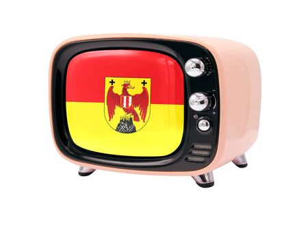 The retro old TV is isolated against a white background with the flag of Burgenland