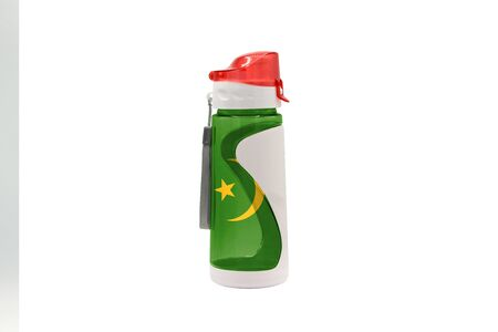 Sports Water Bottle with Mauritania flag on the bottle and isolated on a white background. Healthy lifestyle concept. 免版税图像
