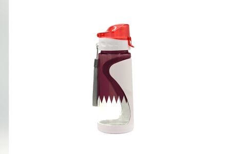 Sports Water Bottle with Qatar flag on the bottle and isolated on a white background. Healthy lifestyle concept. 免版税图像