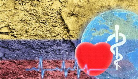 World Health Concept. The flag of Colombia is shown on the cracked wall of the building.
