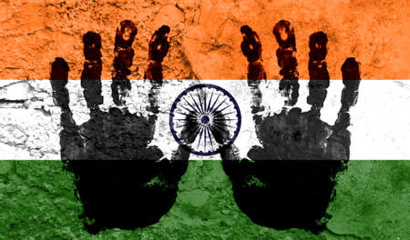 Handprints on the background of the flag of India. Freedom of choice, corruption, and detention concept Archivio Fotografico