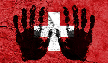 Handprints on the background of the flag of Switzerland. Freedom of choice, corruption, and detention concept