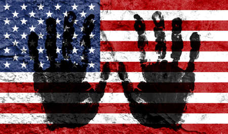 Handprints on the background of the flag of America. Freedom of choice, corruption, and detention concept