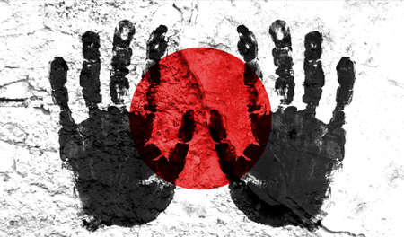 Handprints on the background of the flag of Japan. Freedom of choice, corruption, and detention concept