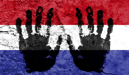 Handprints on the background of the flag of Netherlands. Freedom of choice, corruption, and detention concept Archivio Fotografico
