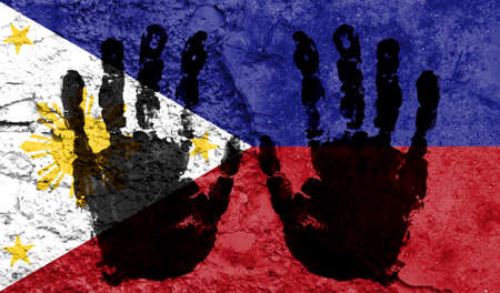 Handprints on the background of the flag of Philippines. Freedom of choice, corruption, and detention concept