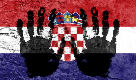 Handprints on the background of the flag of Croatia. Freedom of choice, corruption, and detention concept