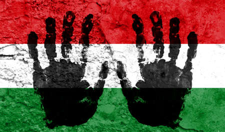 Handprints on the background of the flag of Hungary. Freedom of choice, corruption, and detention concept