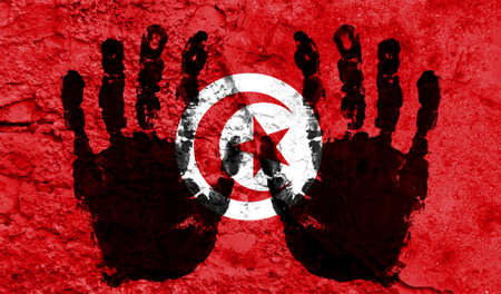 Handprints on the background of the flag of Tunisia. Freedom of choice, corruption, and detention concept