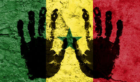 Handprints on the background of the flag of Senegal. Freedom of choice, corruption, and detention concept