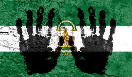 Handprints on the background of the flag of Andalusia. Freedom of choice, corruption, and detention concept
