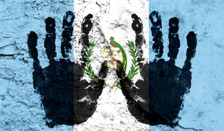 Handprints on the background of the flag of Guatemala. Freedom of choice, corruption, and detention concept