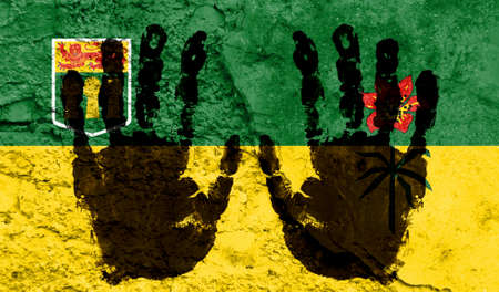Handprints on the background of the flag of Saskatchewan. Freedom of choice, corruption, and detention concept