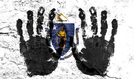 Handprints on the background of the flag of State of Massachusetts. Freedom of choice, corruption, and detention concept