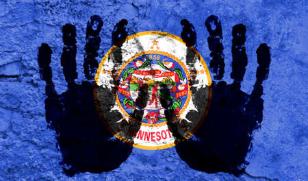 Handprints on the background of the flag of State of Minnesota. Freedom of choice, corruption, and detention concept