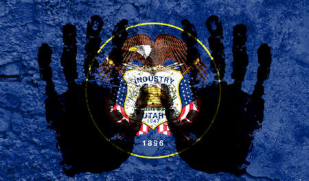 Handprints on the background of the flag of State of Utah. Freedom of choice, corruption, and detention concept Archivio Fotografico