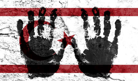 Handprints on the background of the flag of Turkish Republic of Northern Cyprus. Freedom of choice, corruption, and detention concept Imagens