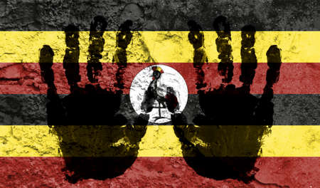 Handprints on the background of the flag of Uganda. Freedom of choice, corruption, and detention concept Stock fotó