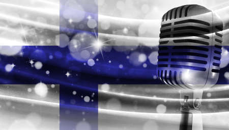 Microphone on a background of a blurry flag Finland close-up, a design concept for your layout with a good place for text and images.